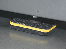 GenieMat TMIP placed under a treadmill to isolate sound and vibration